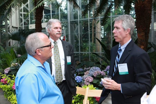 Award winners Steve Panzner, Robert Brooks, and Doug Norris converse during the ceremony reception.