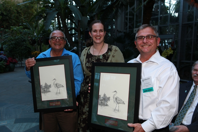 Steve and Jerry Panzner with Marlys Osterhues of the Federal Highway Administration who presented their awards.
